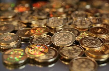 Bitcoin, celebra monedă virtuală, va consuma în curând mai multă energie electrică decât Danemarca